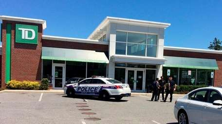 Suffolk police investigate the robbery of a TD