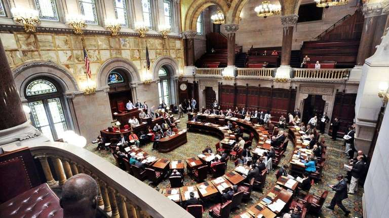 New York state senators work in the Senate