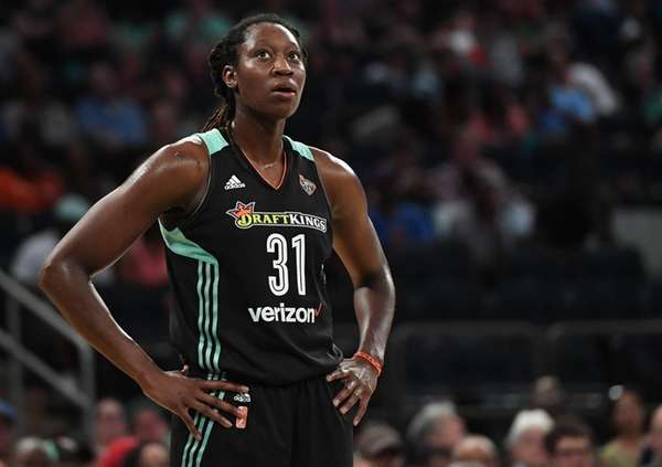 Liberty center Tina Charles looks on against theStormat