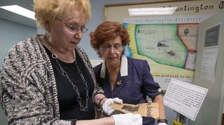 Town Clerk Jo-Ann Raia, left, and town archivist