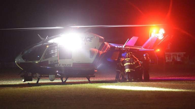 Eastport firefighters load an injured youth into a