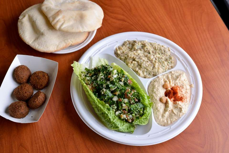 Falafel, tabbouleh, hummus and baba ganoush are served