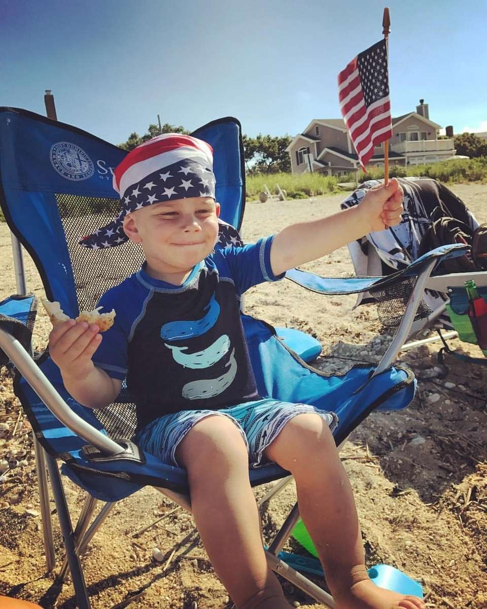 Our grandson, Carl JP Bishop enjoying the 4th