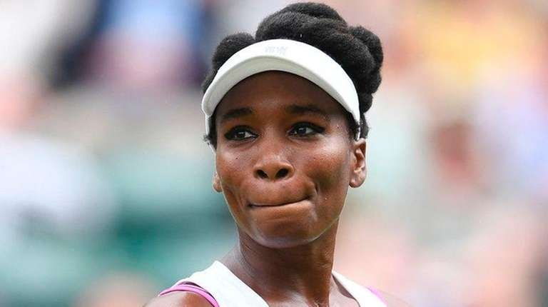 Venus Williams reacts between points against Belgium's Elise