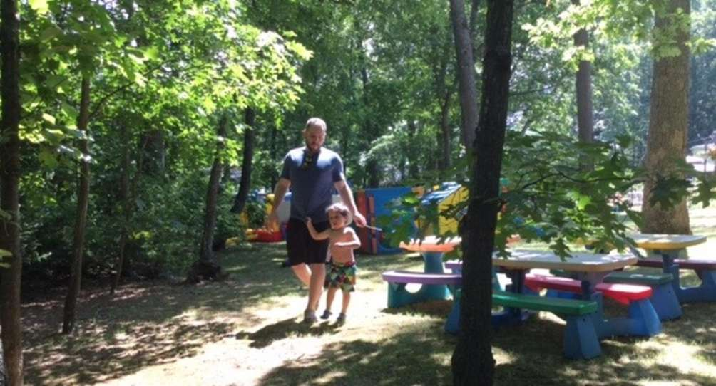 Todd and his son Oren stroll the