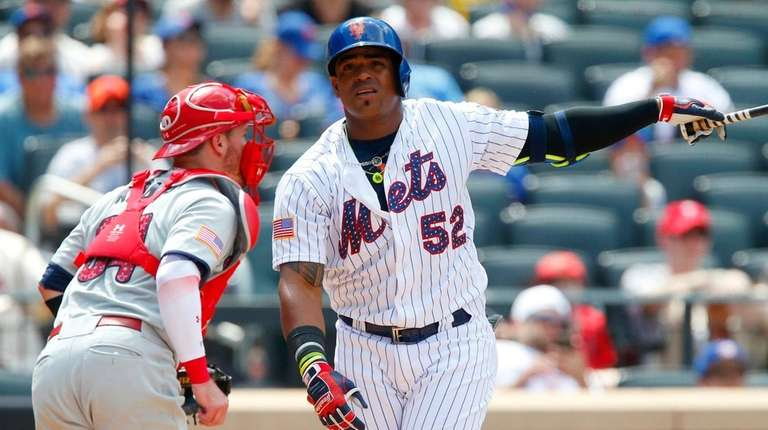 Yoenis Cespedes of the Mets strikes out to