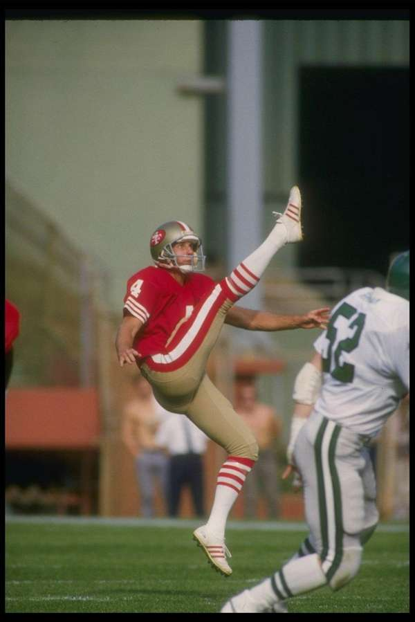 Punter Max Runager of the 49ers kicks the