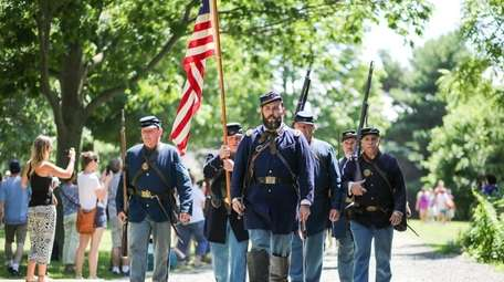 Union soldiers march in a parade during an