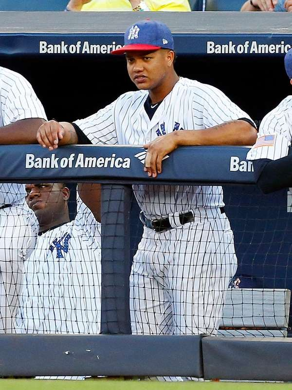Starlin Castro #14 of the Yankees looks on