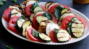 Grilled eggplant and zucchini layered with sliced tomato,