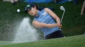 Kelly Shon chips out of a sand trap