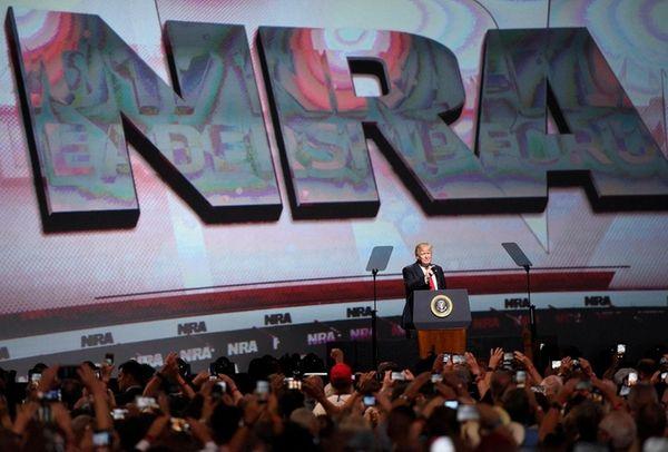 President Donald Trump addresses the National Rifle Association-ILA