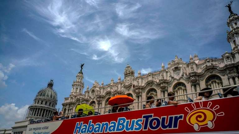 Tourists in front of the Capitolio in Havana,