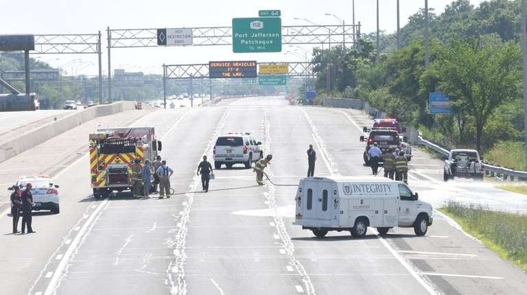 A pickup truck carrying pool chemicals caught on