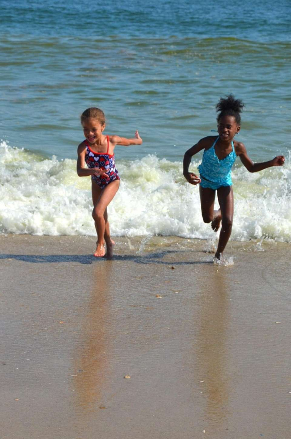 Eryn and Allie running from the wave!
