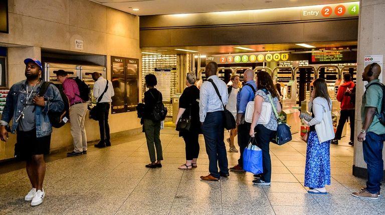 LIRR commuters wait on line to buy Metrocards