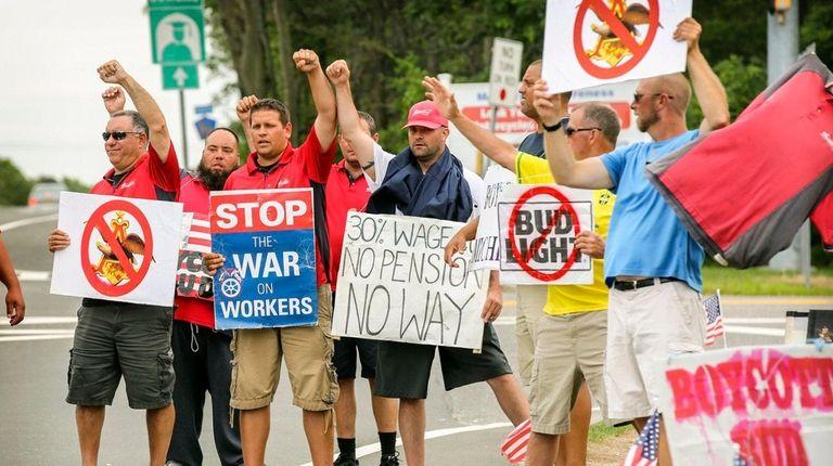 Striking employees of beer distributor Clare Rose on