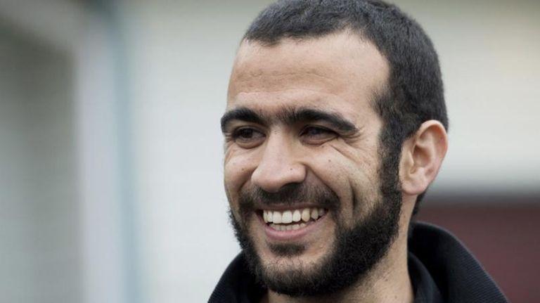 Omar Khadr speaks to the media outside his
