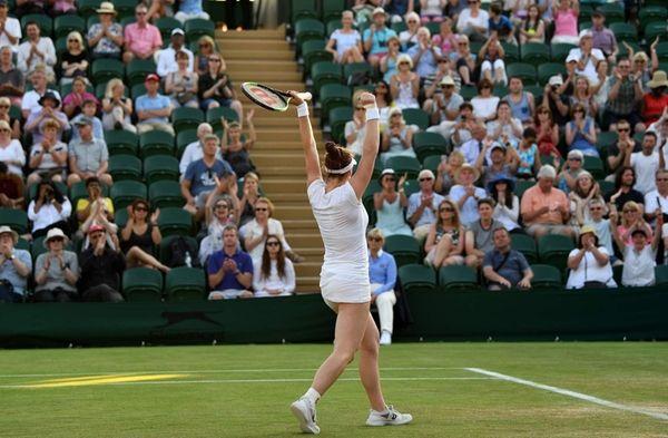 Madison Brengle reacts after winning against Petra Kvitova