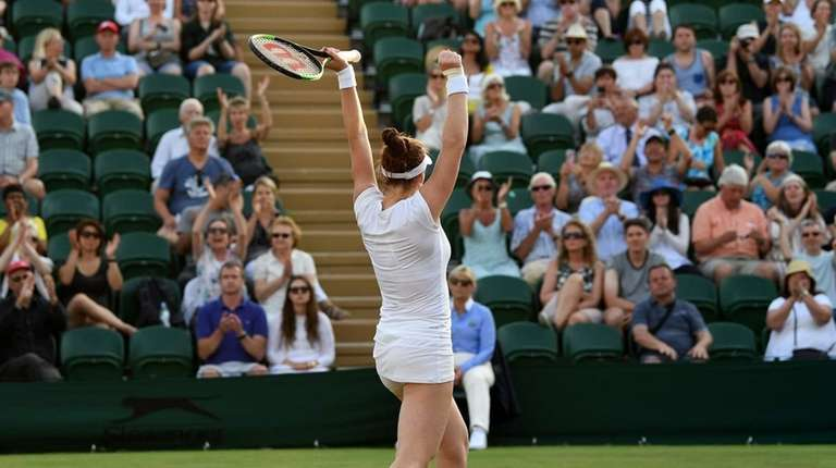 Madison Brengle reacts after winning against Petra Kvitova