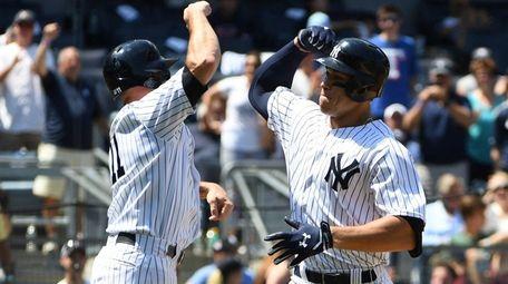 Yankees leftfielder Brett Gardner greets Aaron Judge after