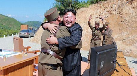 North Korean leader Kim Jong Un celebrates the