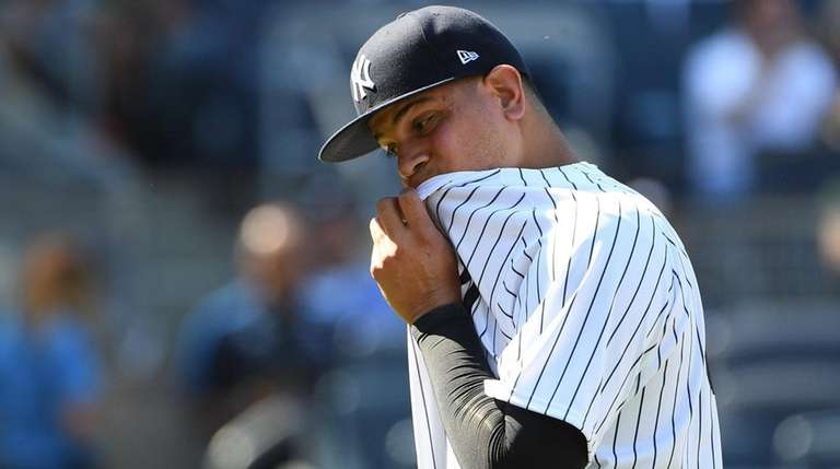 Yankees reliever Dellin Betances walks to the dugout