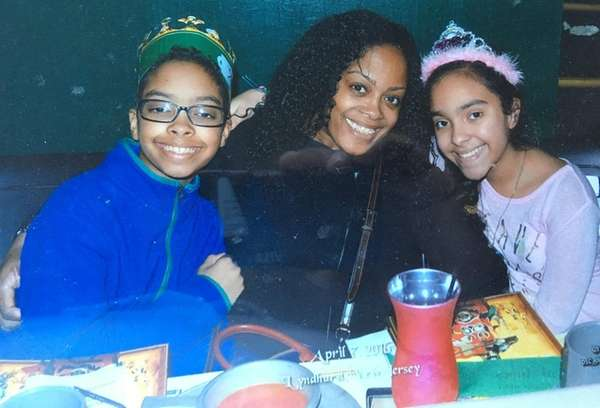 Slain NYPD Officer Miosotis Familia, center, with her