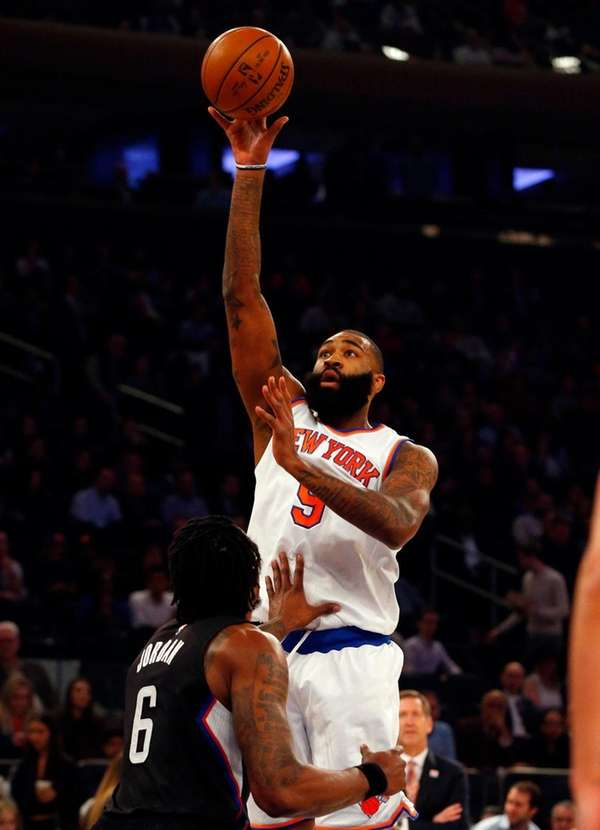 Kyle O'Quinn of the Knicks puts up a