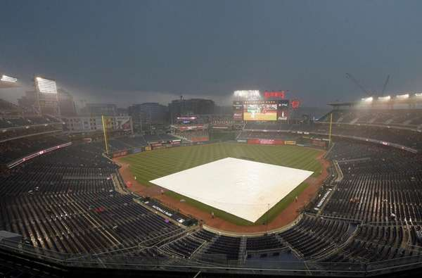The tarp lies on the field before a