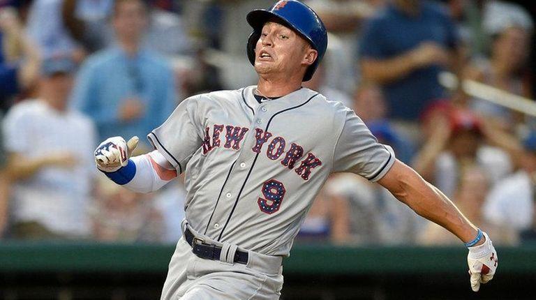 The Mets' Brandon Nimmo runs home againstNationals catcher