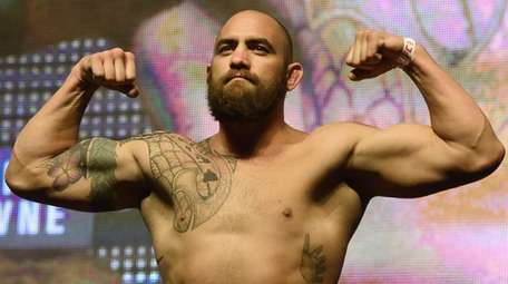 Travis Browne poses on the scale during his