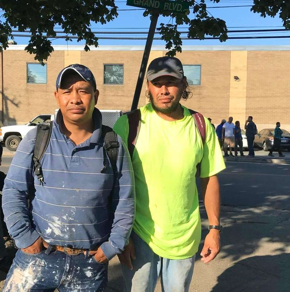 Day laborers stand on the corner of Grand