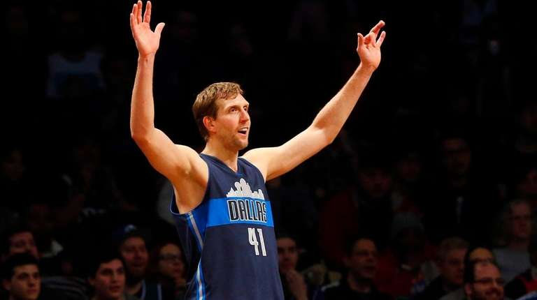 Dirk Nowitzki of the Dallas Mavericks reacts during