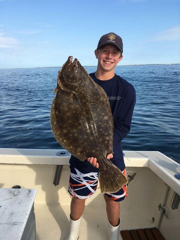 John Lajda shows off the 12.4-pound doormat fluke