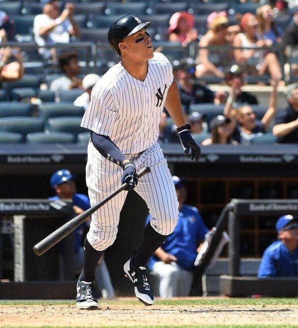 Yankees rightfielder Aaron Judge watches hishome run against