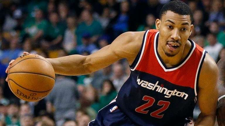 The Wizards' Otto Porter Jr. drives past the