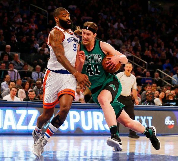 Kelly Olynykof the Boston Celtics drives to the