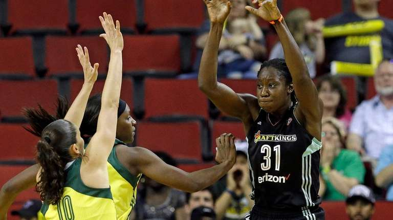 The Liberty's Tina Charles throws a pass as