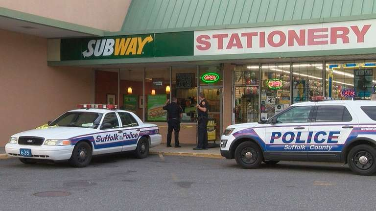Suffolk County police investigate a robbery of a