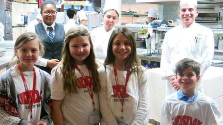 Kidsday reporters from Bayport in the working kitchen