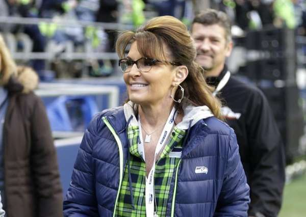 Sarah Palin walks on the sideline before an