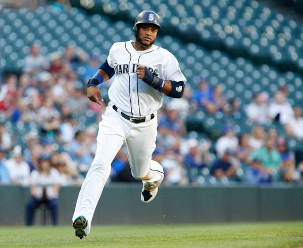 Robinson Cano of the Seattle Mariners heads home