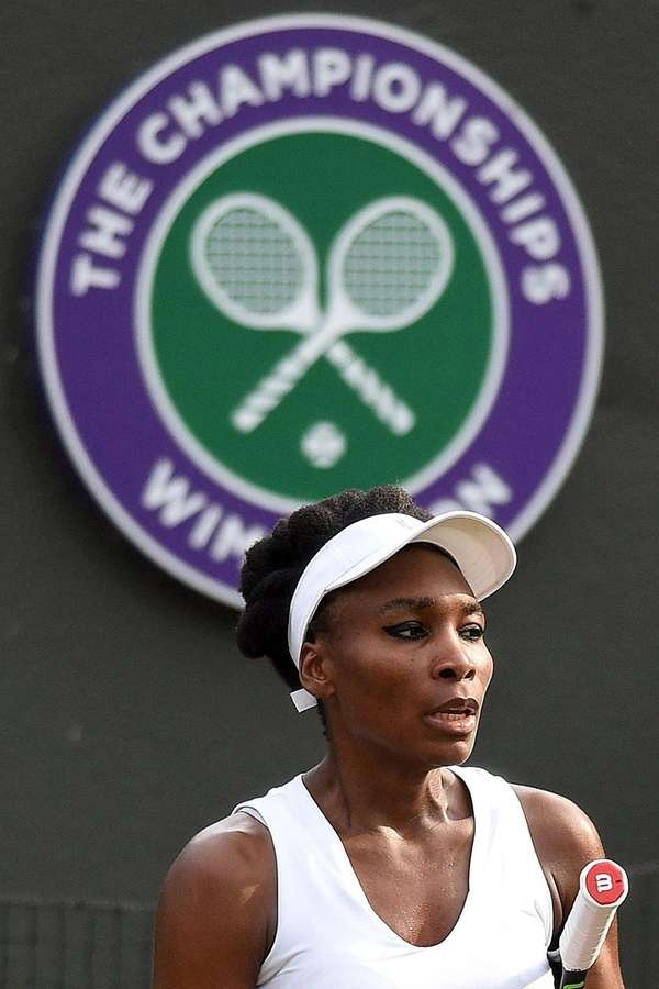 Venus Williams reacts against Naomi Osaka at Wimbledon
