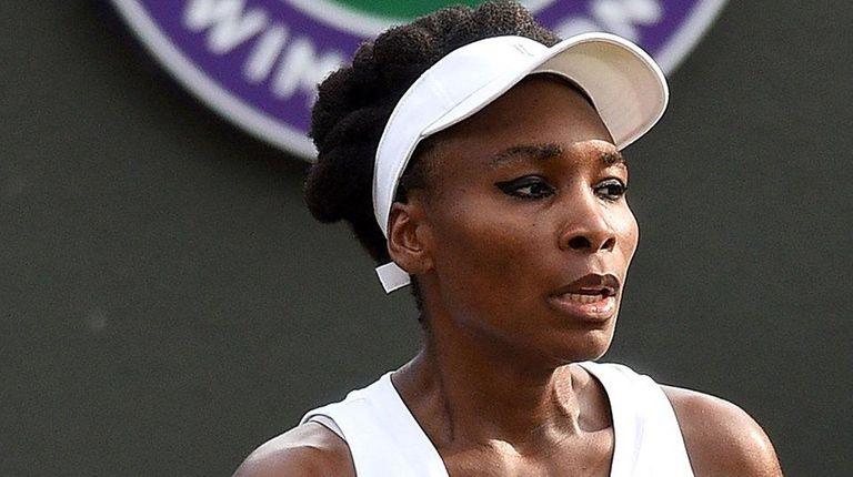 Venus Williams reacts against Naomi Osaka at Wimbledon