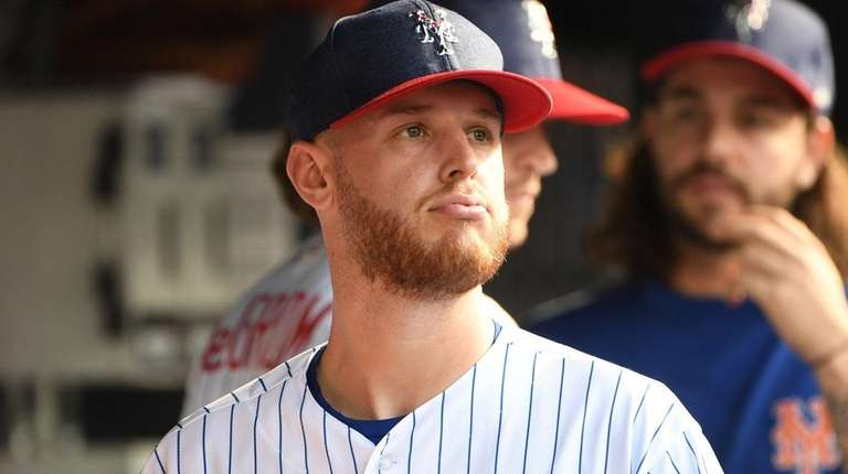 Mets pitcher Zack Wheeler looks on against the Philliesat