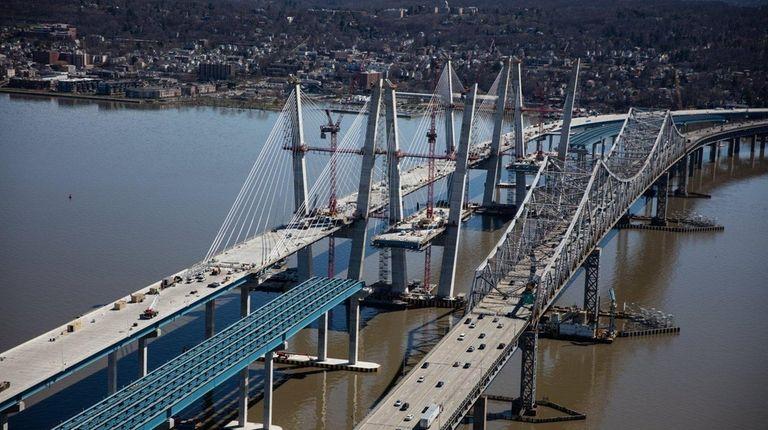 The new Tappan Zee Bridge, left, rises next