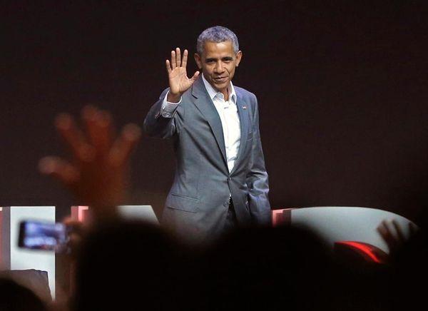 Former U.S. President Barack Obama waves at the