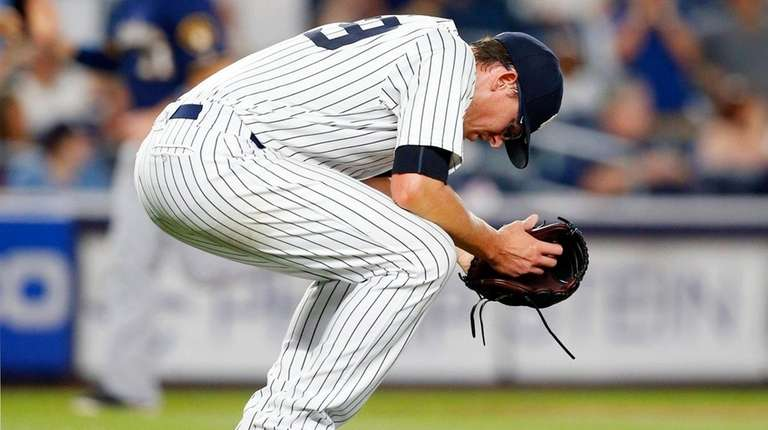 Tyler Clippard of the Yankees reacts after surrendering