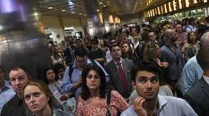 Long Island Rail Road passengers wait for the